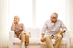 Senior couple sitting on sofa at home Royalty Free Stock Image
