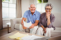Senior couple sitting on sofa Royalty Free Stock Photo