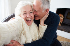 Senior Couple Sitting On Sofa And Relaxing Royalty Free Stock Images