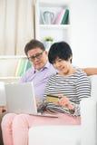 Senior Couple Sitting On Sofa Stock Photography