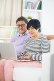 Senior Couple Sitting On Sofa Royalty Free Stock Images
