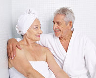 Senior couple sitting in spa in holidays Stock Images
