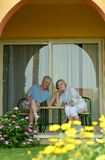 Senior couple sitting at tropic garden Royalty Free Stock Images