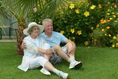 Senior couple sitting at tropic garden Royalty Free Stock Photo