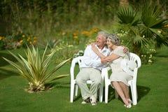 Senior couple sitting at tropic garden Royalty Free Stock Photography