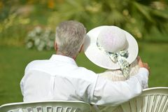 Senior couple sitting at tropic hotel garden Stock Images