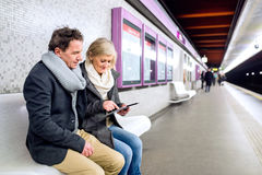 Senior couple sitting at the underground platform, waiting Royalty Free Stock Photos