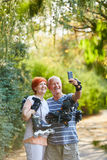 Senior couple with skates in the nature Stock Photos