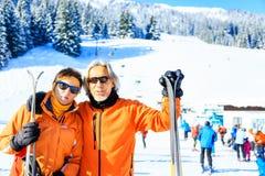 Senior Couple Skiing. Active senior couple skiing, enjoying a clear winter day stock photo