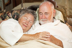 Senior Couple Sleeping Stock Images