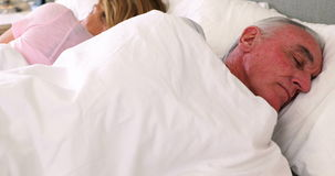 Senior couple sleeping on bed stock footage
