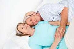 Senior couple sleeping in bed royalty free stock photos