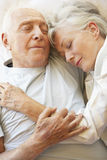 Senior Couple Sleeping In Bed royalty free stock photography