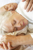 Senior Couple Sleeping In Bed royalty free stock photo