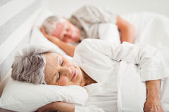 Senior couple sleeping on bed Royalty Free Stock Photography