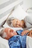 Senior couple sleeping on bed Royalty Free Stock Photo