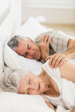Senior couple sleeping in bed Stock Images
