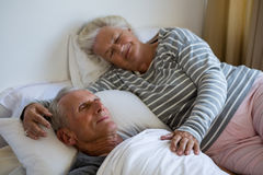 Senior couple sleeping on bed in nursing home Royalty Free Stock Photos