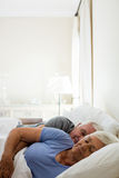 Senior couple sleeping in the bedroom Royalty Free Stock Photo
