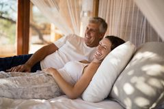 Senior couple sleeping on canopy bed Royalty Free Stock Photos