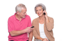 Senior couple with smartphone Royalty Free Stock Photography