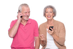 Senior couple with smartphone Royalty Free Stock Photos