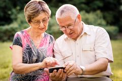 Senior couple with smartphone Royalty Free Stock Image