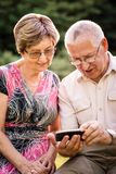 Senior couple with smartphone Stock Photos