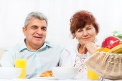 Senior couple smile having breakfast Stock Photo