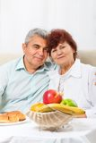 Senior couple smile having breakfast Royalty Free Stock Images