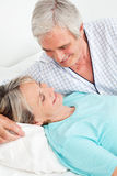 Senior couple smiling in bed Stock Photo