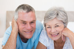 Senior couple smiling in bed Royalty Free Stock Images