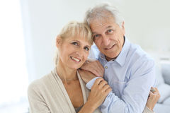 Senior couple smiling at home Stock Photos