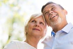 Senior couple smiling. Loving senior couple standing outdoors Stock Photography