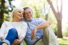Senior couple smiling. Loving senior couple standing outdoors Stock Images
