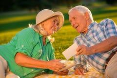 Senior couple is smiling. Royalty Free Stock Photos