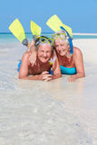 Senior Couple With Snorkels Enjoying Beach Holiday Royalty Free Stock Images