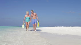 Senior Couple With Snorkels Enjoying Beach Holiday stock footage