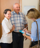 Senior couple with social worker at home Stock Image