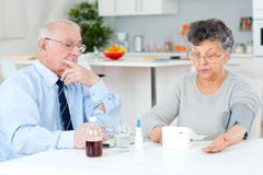 Senior couple sorting their medications for week. Senior couple sorting their medications for the week Royalty Free Stock Images