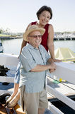 Senior Couple Spending Vacation At Harbor Stock Photography