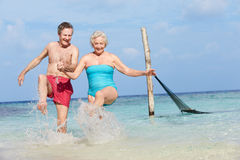 Senior Couple Splashing In Beautiful Tropical Sea Stock Images