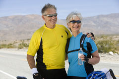 Senior Couple In Sportswear Looking Away Stock Image