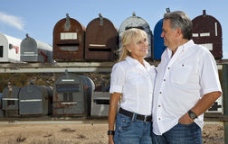 Senior couple stand in front of rural mailboxes Royalty Free Stock Image