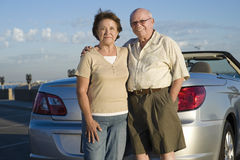 Senior Couple Standing Against Car Royalty Free Stock Photo
