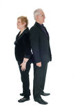 Senior couple standing back to back. Stock Photography