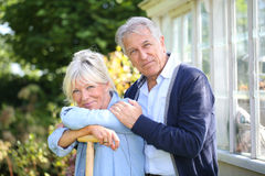 Senior couple standing at the backyard Royalty Free Stock Photography