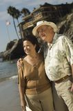 Senior Couple Standing At Beach Royalty Free Stock Photo
