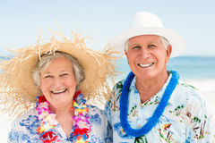 Senior couple standing at the beach. On a sunny day Royalty Free Stock Photography