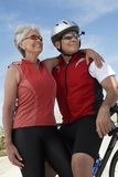 Senior Couple Standing By Bicycle Royalty Free Stock Photo